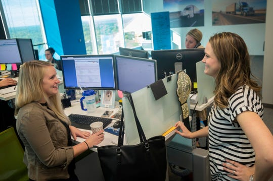 Hilary Wilke, 26, of Royal Oak, left, and an operations manager speaks with Stephanie Cook, 35, of Livonia director of Freight Operations at Worldwide Express.