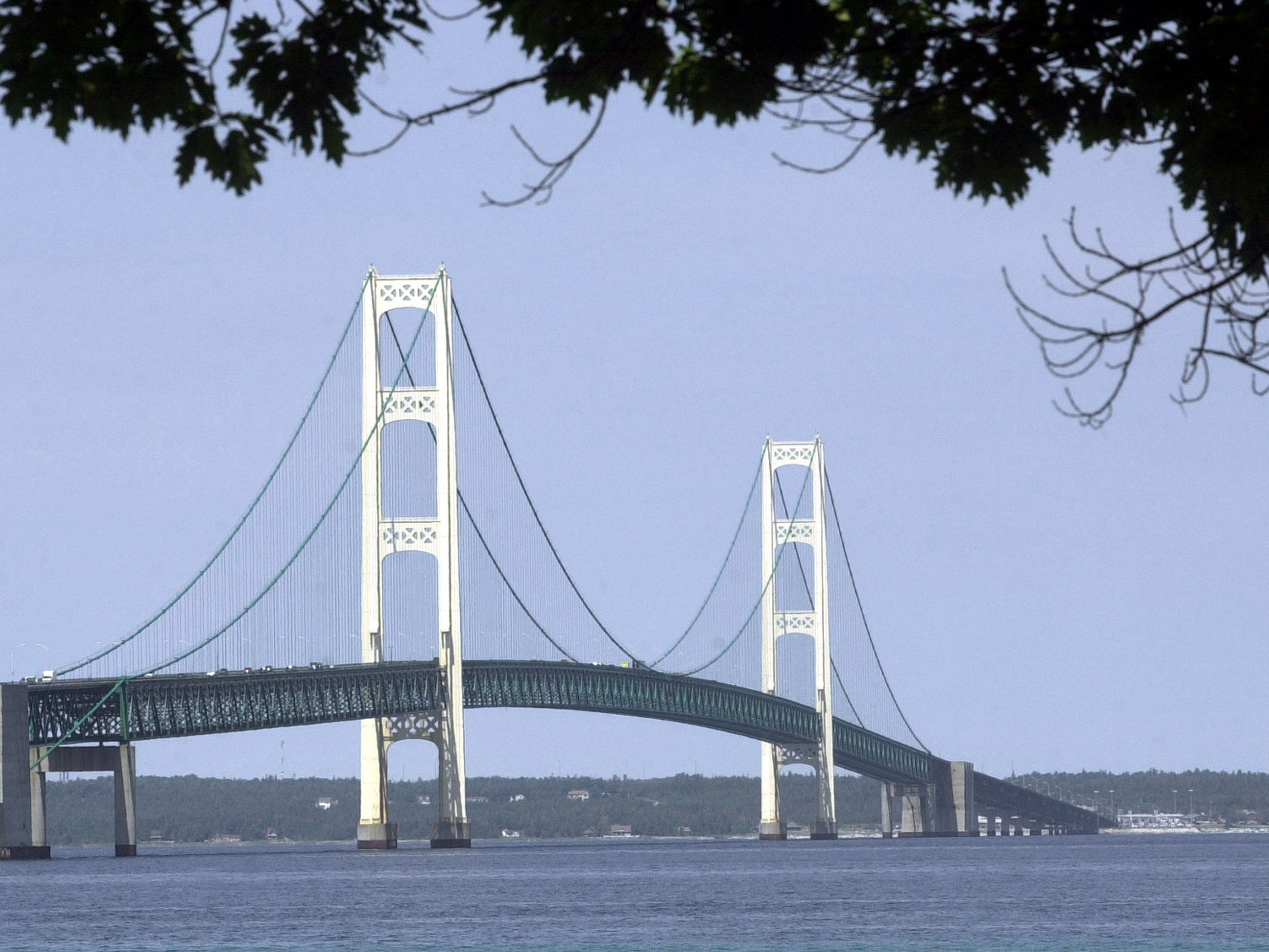 In this  July 19, 2002 file photo, the Mackinac Bridge is shown from Mackinaw City, Mich. The bridge connecting Michigan's two peninsulas is steeling itself for a national engineering accolade. The Mackinac Bridge is being designated Thursday, Aug. 12, 2010 as a National Historic Civil Engineering Landmark.