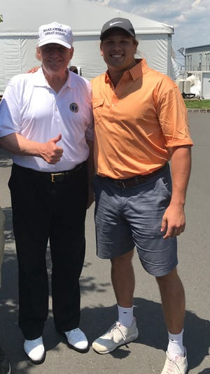 Michigan defensive end Chase Winovich with President Donald Trump.