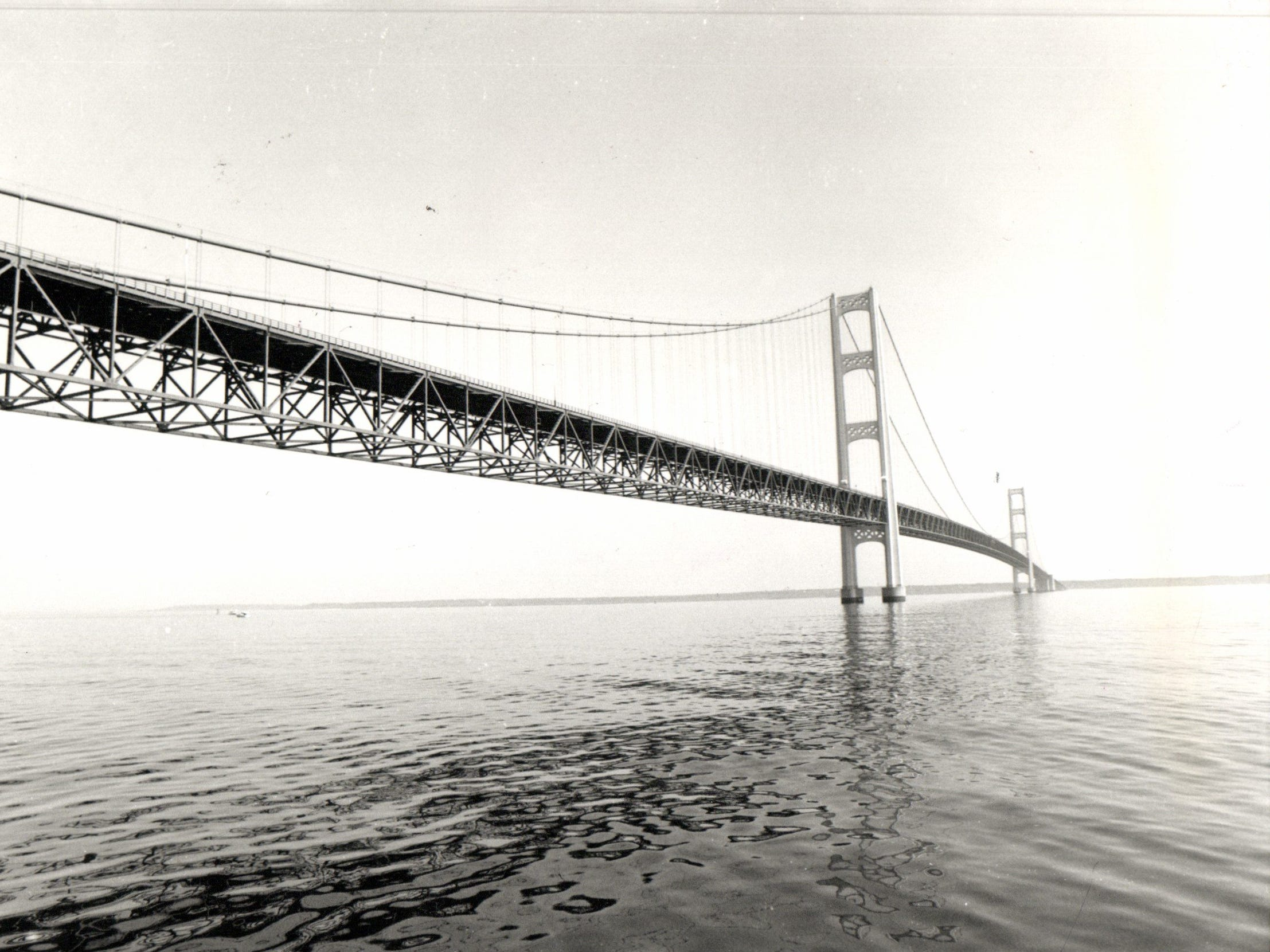 "Opened in 1957, the bridge (familiarly known as ""Big Mac"" and ""Mighty Mac"") is the third longest in total suspension in the world and the longest suspension bridge between anchorages in the Western hemisphere. The Mackinac Bridge carries Interstate 75 across the straits and connects the city of St. Ignace on the north end with the village of Mackinaw City on the south.
