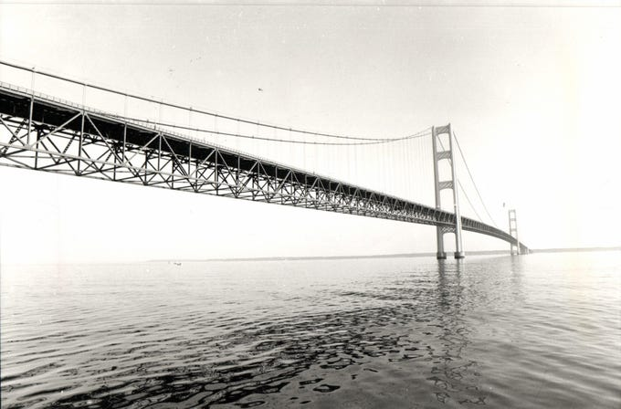 """Opened in 1957, the bridge (familiarly known as """"Big Mac"""" and """"Mighty Mac"""") is the third longest in total suspension in the world and the longest suspension bridge between anchorages in the Western hemisphere. The Mackinac Bridge carries Interstate 75 across the straits and connects the city of St. Ignace on the north end with the village of Mackinaw City on the south.Envisioned since the 1880s, the bridge was designed by engineer David B. Steinman and completed in 1957 only after many decades of struggles to begin construction."""