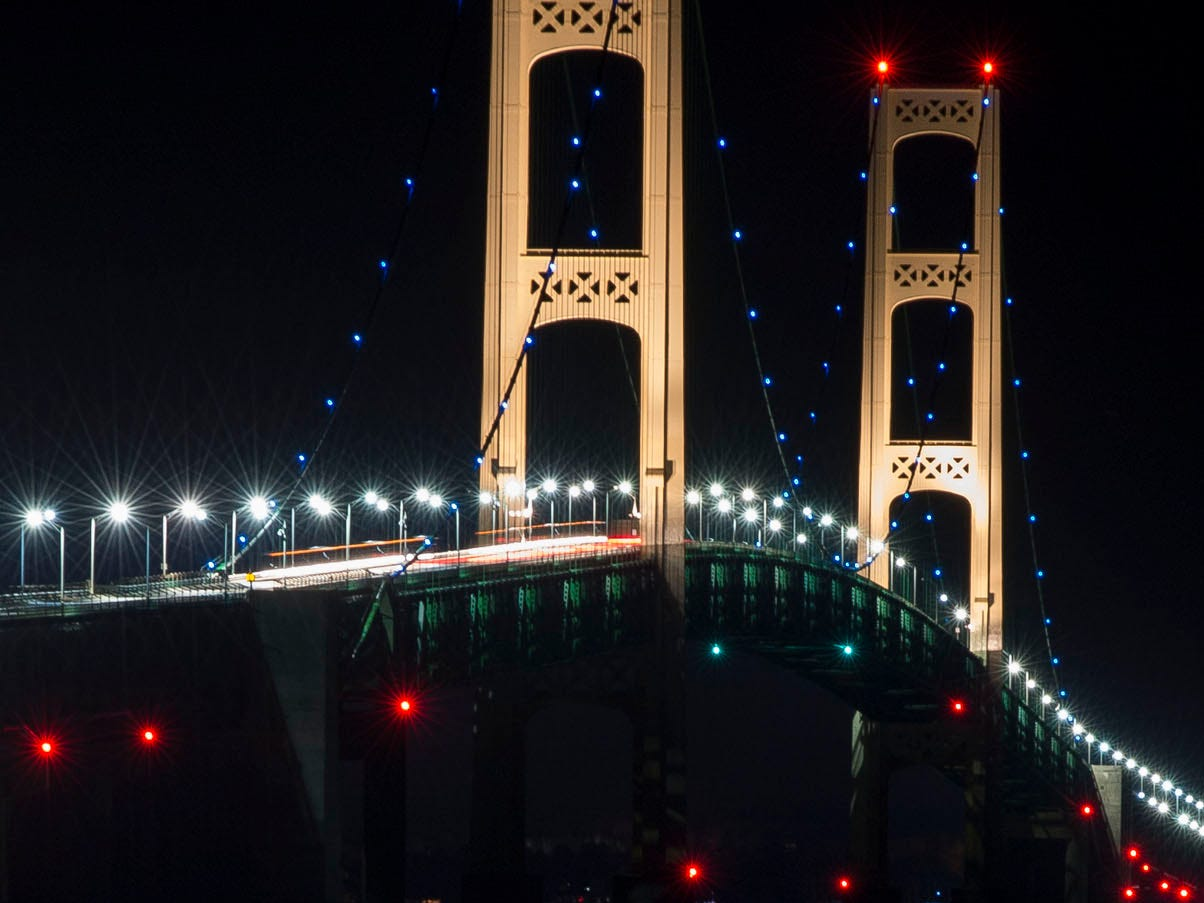 This photo released by the Michigan Department of Transportation, shows the Mackinac Bridge, which runs from St. Ignace, Mich., to Mackinaw City, Mich., and links the states Upper and Lower peninsulas, was lit with strings of blue lights on Tuesday, April 2, 2013, as part of an effort to mark awareness of autism.
