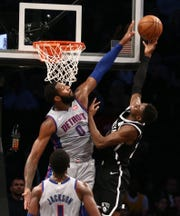Detroit Pistons center Andre Drummond (0) defends against Brooklyn Nets guard Caris LeVert (22) in the second quarter at Barclays Center.