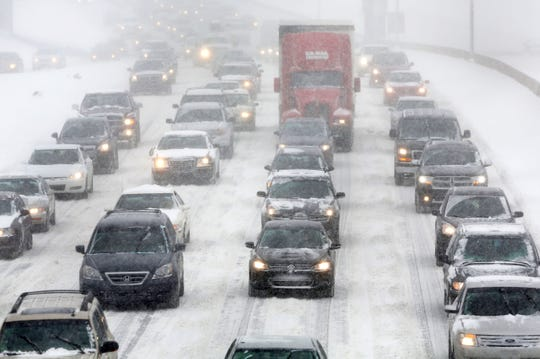 Traffic on I-96 in Detroit headed into downtown craws slowly during a morning snow storm that hit the area on Wednesday, February 5, 2014.