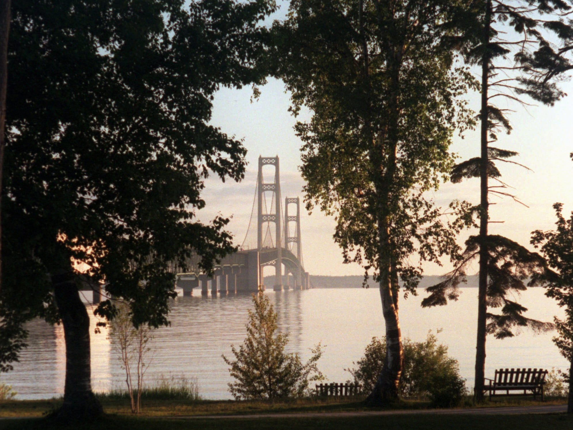 An early morning view of the Mackinac Bridge from Alexander Henry Park in Mackinaw City. Tourism is on the rise in Mackinaw City with added beachside hotels and the new Disney-esque shopping entertainment center called Mackinaw Crossings.