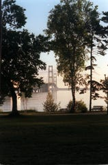 An early morning view of the Mackinac Bridge from Alexander Henry Park in Mackinaw City. Tourism is strong in Mackinaw City.