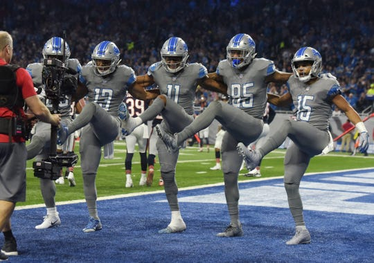 The Lions' Theo Riddick, TJ Jones, Marvin Jones Jr., Eric Ebron and Golden Tate celebrate Jones' touchdown in a game last season against the Bears at Ford Field.