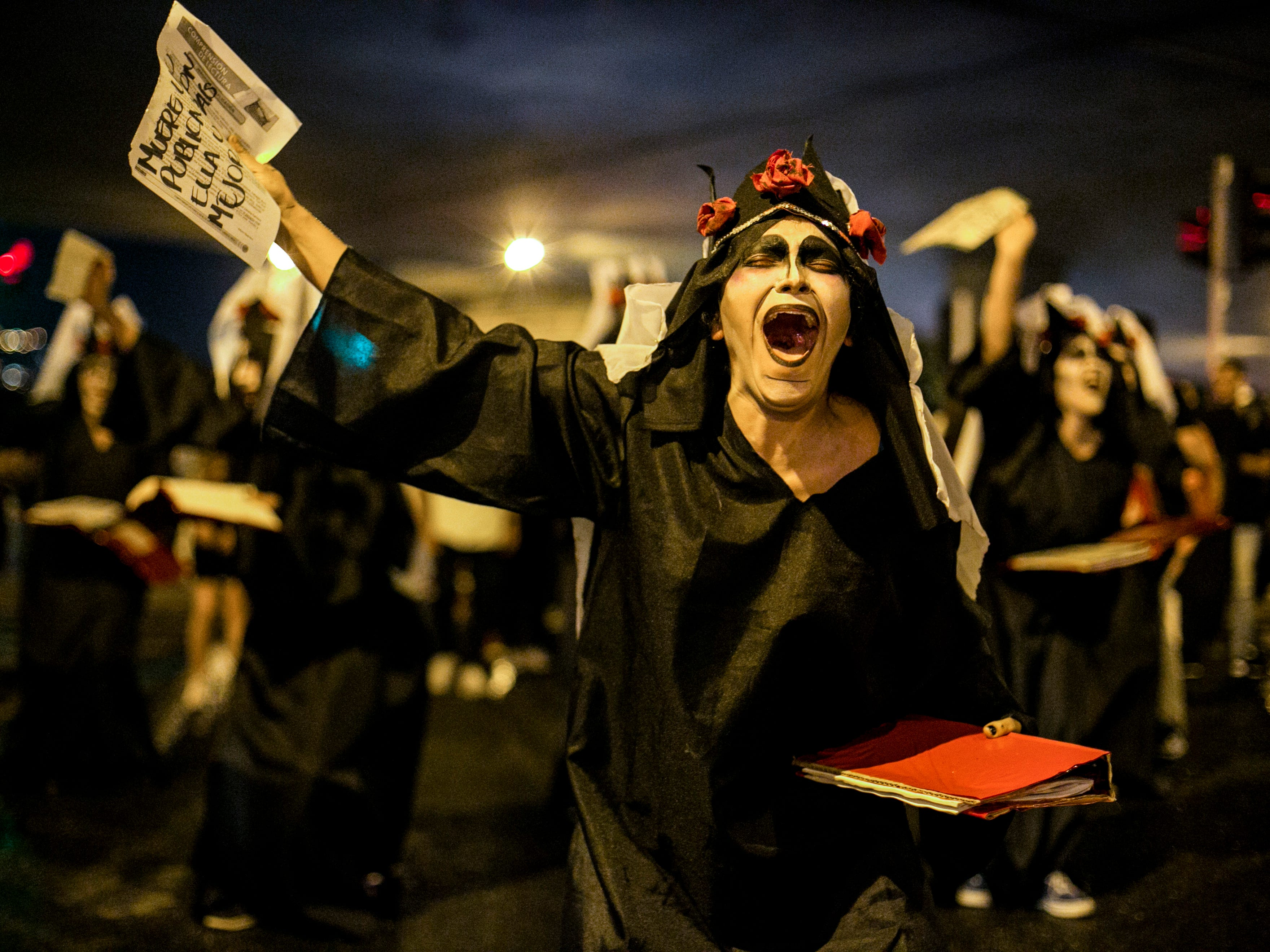 A university student shouts slogans while taking part in a demonstration in demand of a budget increase for the Colombian tertiary education in Medellin, Colombia, on October 31, 2018