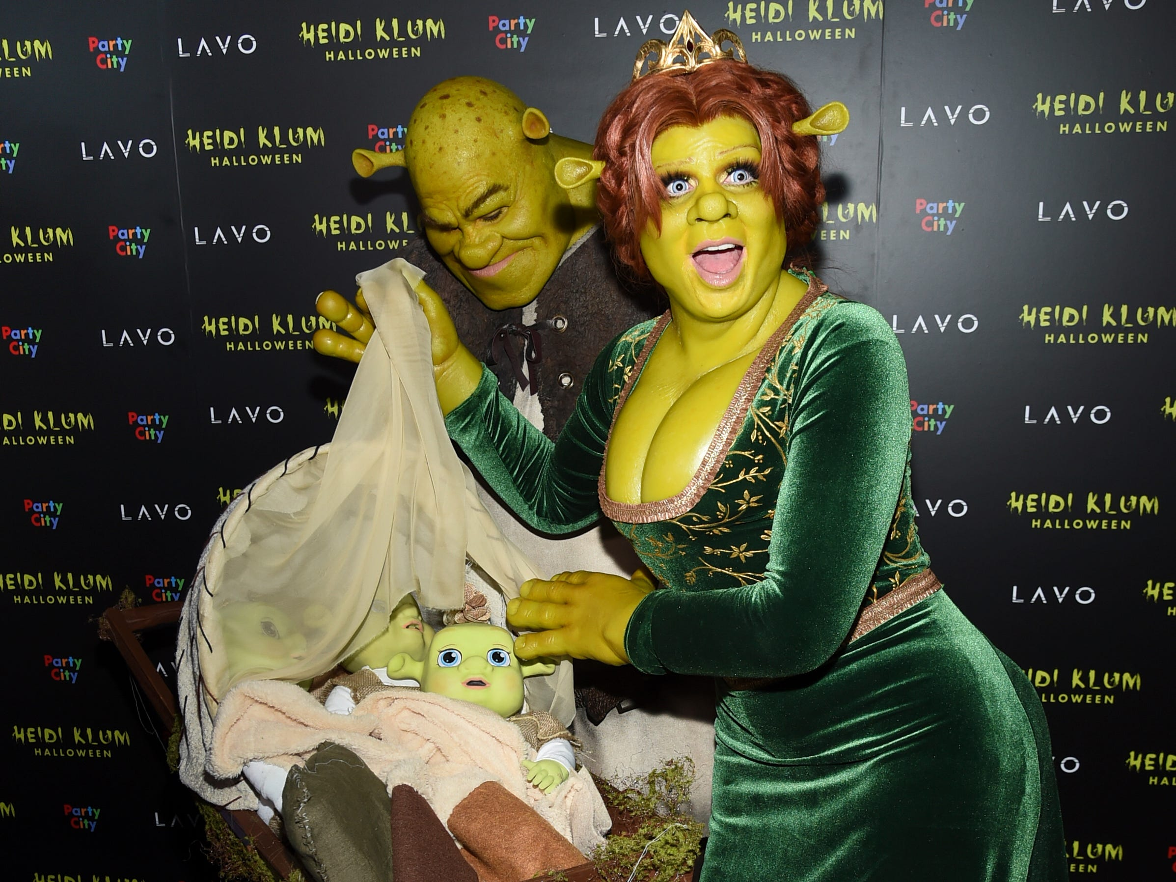 Model and television personality Heidi Klum, right, and boyfriend Tom Kaulitz dress as Shrek and Princess Fiona as they arrive at her 19th annual Halloween party at Lavo New York on Wednesday, Oct. 31, 2018.
