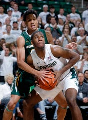 Michigan State's Aaron Henry, front, had six points in 14 minutes in Tuesday's exhibition victory over Northern Michigan.