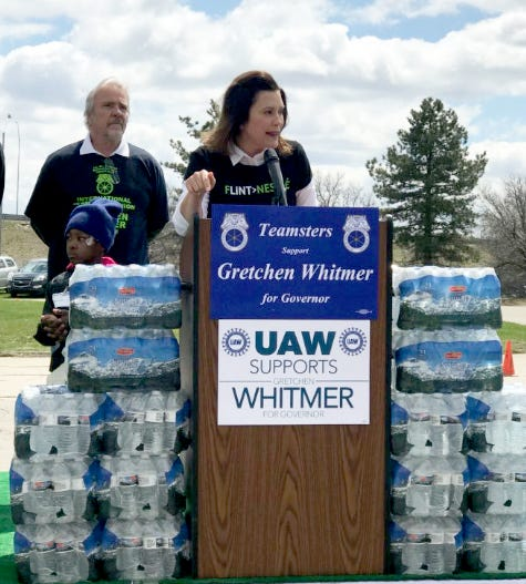 Gretchen Whitmer campaigns in Flint on April 28 and helps with a bottled water distribution. The Democratic gubernatorial candidate has attacked her GOP opponent Bill Schuette for purportedly ignoring early complaints about the Flint water crisis.