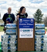 Gretchen Whitmer campaigns in Flint on April 28, 2018, and helps with a bottled water distribution.