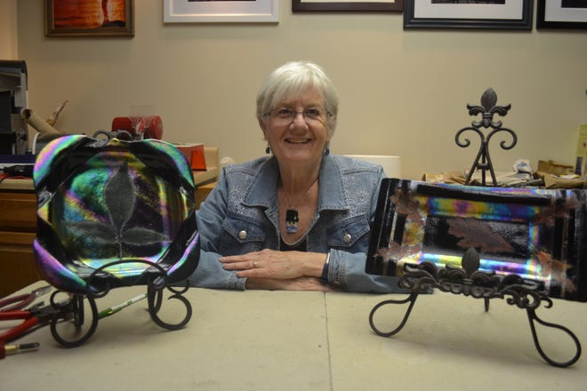 Jill Groves with her leaf art in her home art studio.