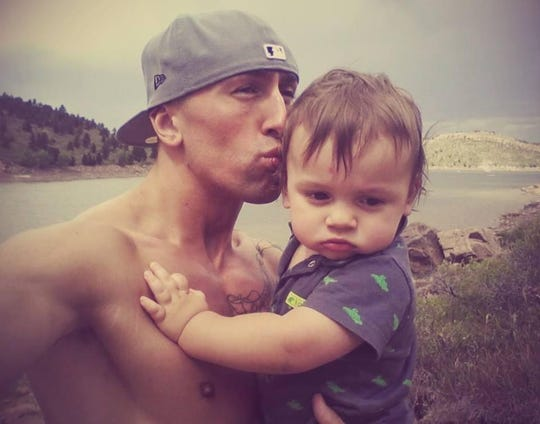 Rich Kutch holds son Duke on his first birthday at Horsetooth Reservoir on Aug. 31, 2013. Two days later Rich went missing in Virginia and several days later they found his body in a state park.