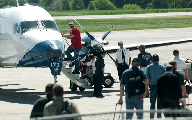 Passengers board a Great Lakes Airline plane at the Cheyenne Regional Airport in June 2010 when American Eagle offered flights out of Cheyenne.