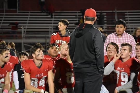 Eaton High School football coach Zac Lemon talks to his team after an Oct. 12, 2018, loss to visiting Resurrection Christian.