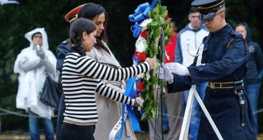 Carina Kutch laying the wreath at the Tomb of the Unknown Soldier in Arlington National Cemetery as part of the Wear Blue Group.