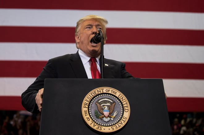 President Donald Trump talks about the media Wednesday evening at Hertz Arena while addressing supporters during a Make America Great Rally October 31, 2018.