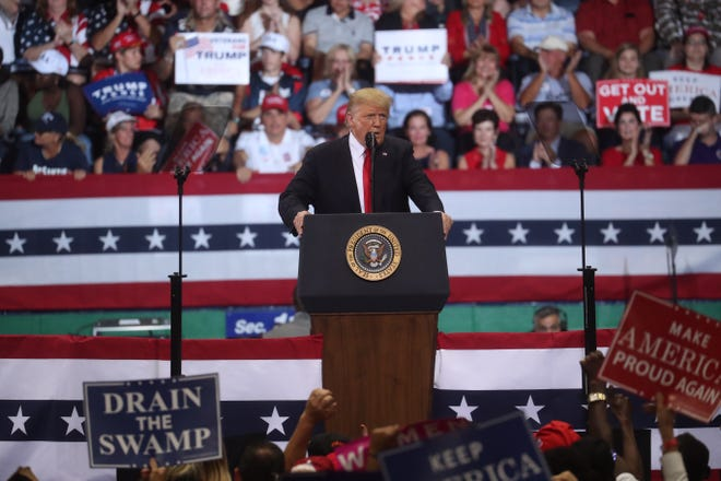 President Donald Trump speaks at his rally at Hertz Arena Tuesday, October 31, 2018.