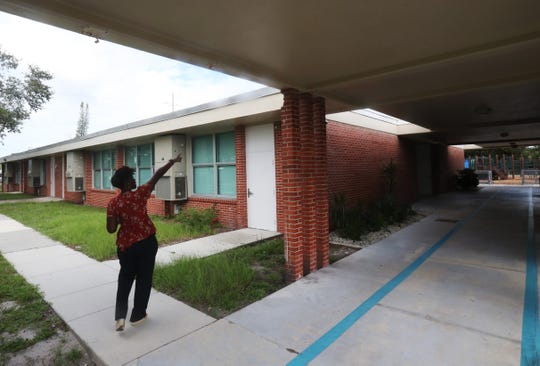 Michelle Freeman, the principal at Franklin Park Elementary in Fort Myers, shows off areas that need repairs. The gym is on the wish list for repair if a half-cent tax increase is approved.