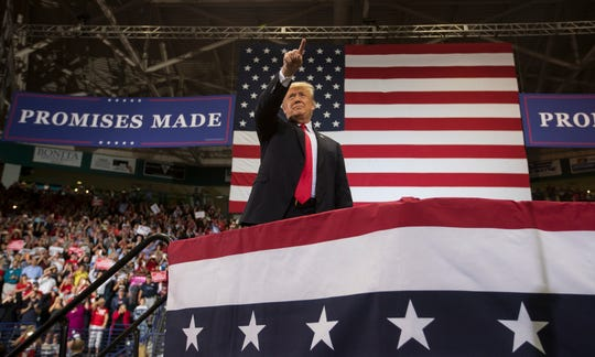 President Donald Trump stands in Hertz Arena in Estero to address his supporters and campaign for Ron DeSantis and Rick Scott on Wednesday, Oct. 31, 2018.