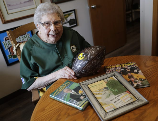 Ellen Johnson, who turned 100 in May, sits in a room  full of Green Bay Packers memorabilia in her Ashwaubenon apartment. She is a longtime fan of the team, and her late husband worked for the Packers controlling the scoreboard for many years.