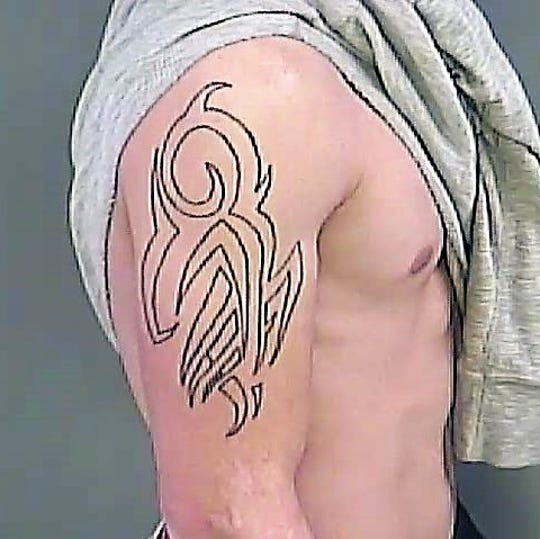 Escaped Anderson County Detention Center inmate Devin Blake Howell has a tattoo on his right shoulder, shown here in a photo from the sheriff's office.