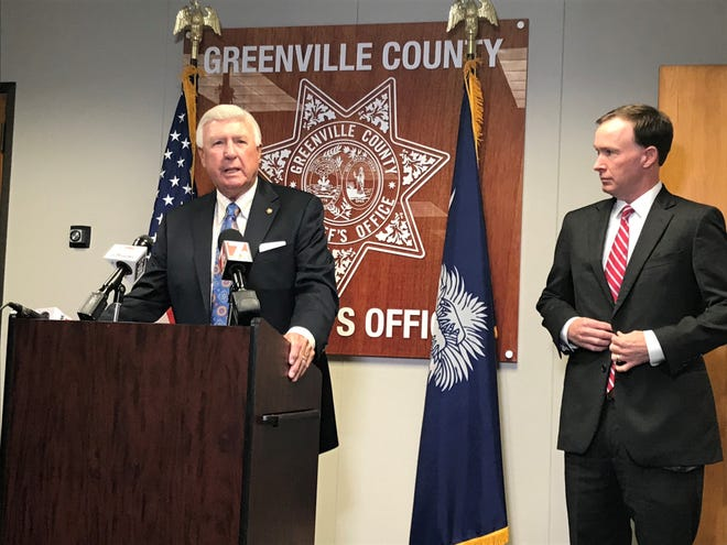 Sheriff Johnny Mack Brown, left, stands with 16th Circuit Solicitor Walt Wilkins to announce a new plan to publicize bodycam footage and other records from critical cases involving deputies.