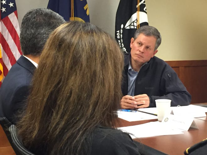 Sen. Steve Daines talks with law enforcement officials Thursday in Helena about Montana's drug problem.