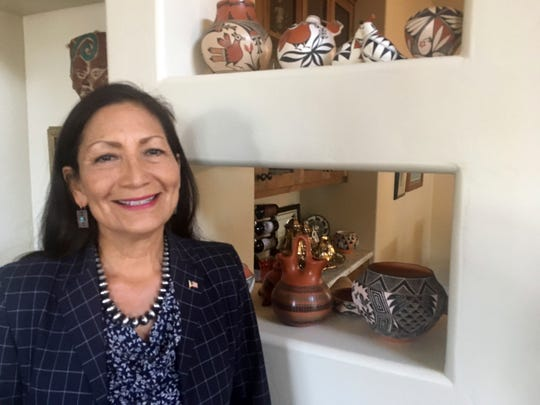 FILE - In this June 6, 2018, file photo, Deb Haaland, a Democratic candidate for Congress for central New Mexico's open seat and a tribal member of the Laguna Pueblo, speaks at her Albuquerque home. Haaland is maintaining her fundraising edge over her Republican and Libertarian opponents for an open U.S. House seat in central New Mexico. (AP Photo/Russell Contreras, File)