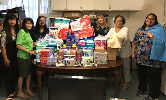 The Pacific Islands Bilingual Bicultural Association Guam members and former CM302 Advanced CHamoru reading students under the instruction of Rosa Salas Palomo donated various items to residents of Luta who were displaced by Typhoon Mangkhut. Donations were sent to the Luta Mayor's Office for distribution. Pictured from left: Mye Ganan-Flores, PIBBA treasurer; Terry Flores, Bobbie Benavente, Dr. Debby Ellen, PIBBA members; Palomo, PIBBA president and Dr. Matilda Naputi Rivera, PIBBA webmaster.