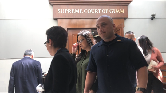 Mark Torre Jr., ex-police officer convicted of negligent homicide and aggravated assault in the shooting death of fellow officer Sgt. Elbert Piolo, leaves the Supreme Court of Guam after his appeal hearing Friday, Nov. 1, 2018 at the Guam Judicial Center in Hagåtña.