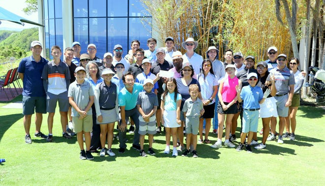 Onward Mangilao Golf Club presented a check on Oct. 7 to Guam Jr. Golf.  The proceeds came from the annual Fun Run held at the golf course.