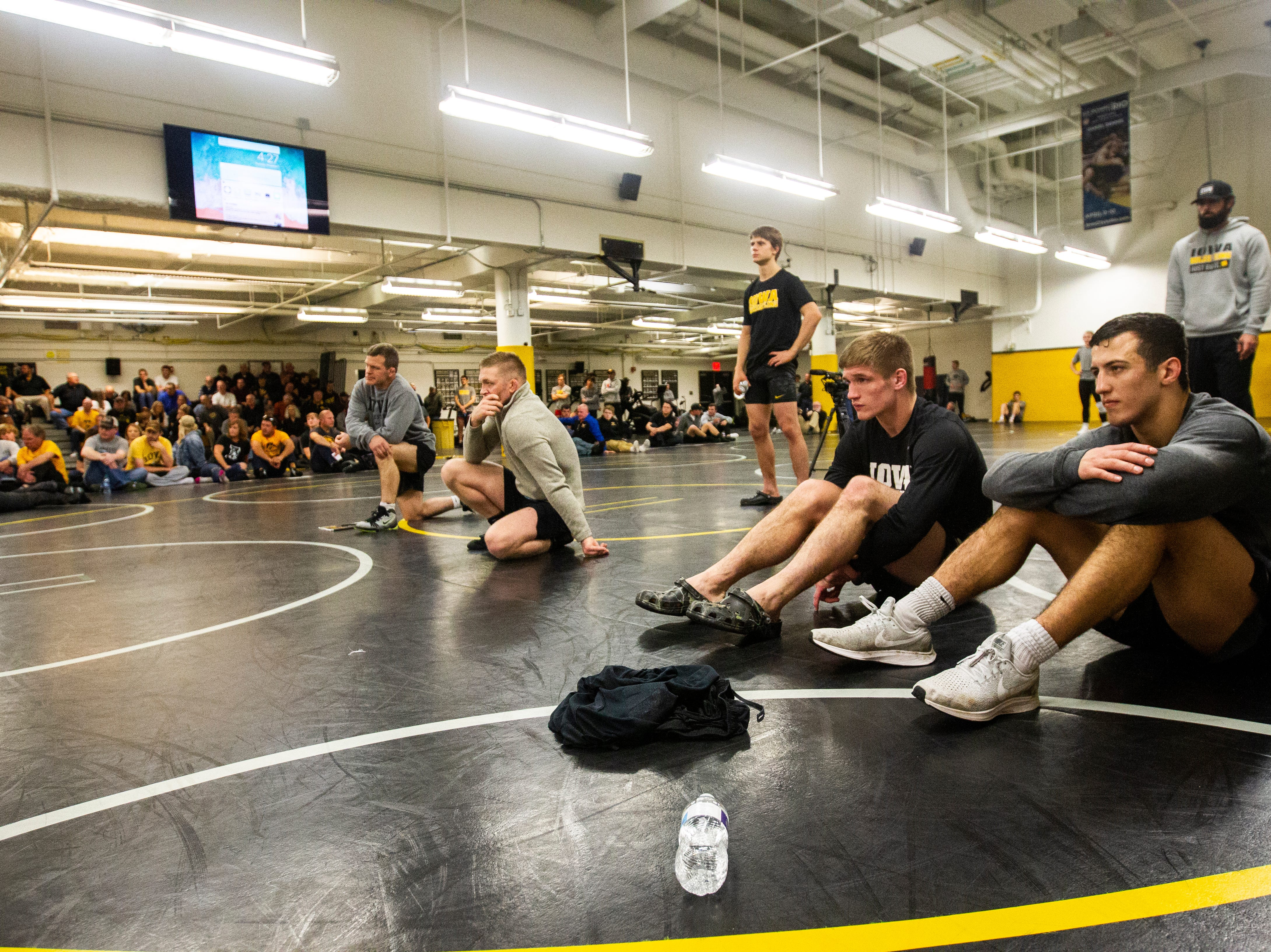 Iowa's Michael Kemerer (far right) watches a match during the wrestle-offs on Thursday, Nov. 1, 2018, inside the Dan Gable Wrestling Complex at Carver-Hawkeye Arena in Iowa City.