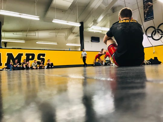 Iowa freshman Nelson Brands waits for his match during Thursday's wrestle-off at the Dan Gable Wrestling Complex in Iowa City.