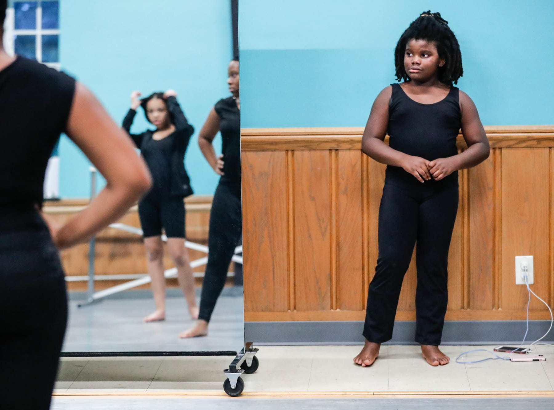 Leslie Raysor watches a routine during an Iibada Dance Company class at Broadway United Methodist Church in Indianapolis Ind. on Wednesday, Oct. 31, 2018. The children's nonprofit dance studio teaches cultural enrichment, discipline, and positive self-esteem through the art of dance.