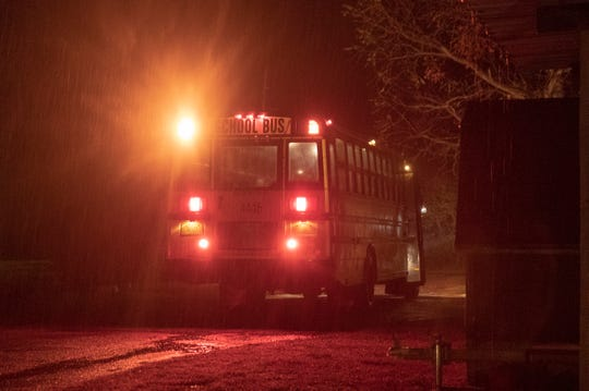 A school bus enters a trailer park on rural Indiana Highway 25, scene of a fatal crash earlier in the week, Rochester, Thursday, Nov. 1, 2018. Prosecutors said Alyssa Shepherd, 24, struck and killed 6-year-old twins Xzavier and Mason Ingle, 6, and their sister Alivia Stahl, 9, as they were crossing the highway to board their school bus north of Rochester in Fulton County.