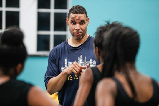 Senior Program Director, Roland Smith, chats wiith students at the end of a Iibada Dance Company class at Broadway United Methodist Church in Indianapolis Ind. on Wednesday, Oct. 31, 2018. The children's nonprofit dance studio teaches cultural enrichment, discipline, and positive self-esteem through the art of dance.
