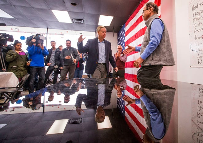 Sen. Lindsey Graham, R-S.C., left, shakes hands with Republican U.S. Senate candidate Mike Braun during a rally on Thursday, Nov. 1, 2018, inside Jackie Walorski's campaign office in Mishawaka, Ind. (Robert Franklin/South Bend Tribune via AP)