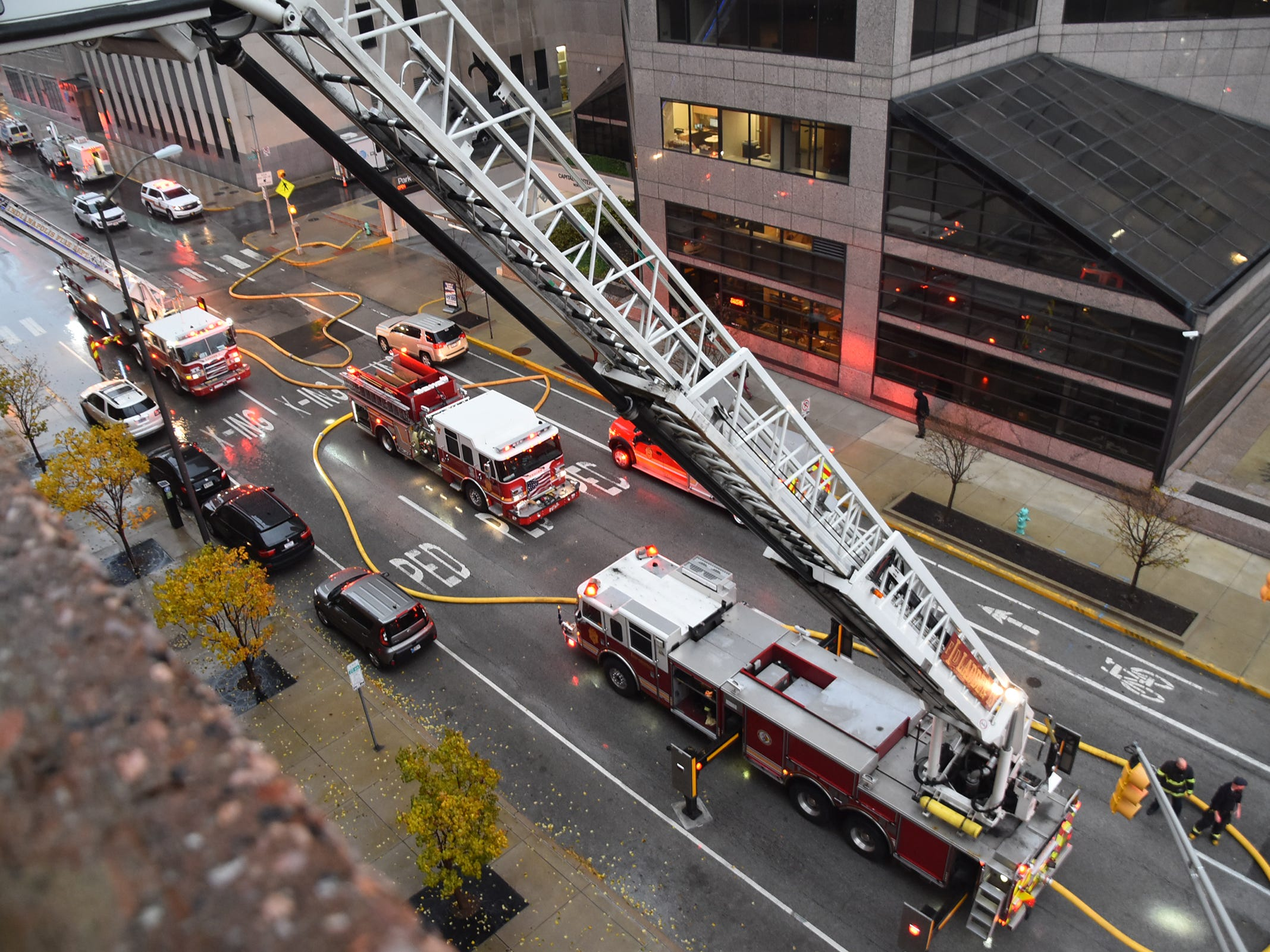 Emergency vehicles are seen down on New York Street as IFD fights a car fire in a parking garage at Illinois and New York, Thursday, Nov. 1, 2018.