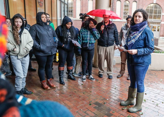 Malkah Bird, with Jewish Voice for Peace, speaks during a Solidarity Vigil and Public Mourning, held at the City Market in Indianapolis on Thursday, Nov. 1, 2018.