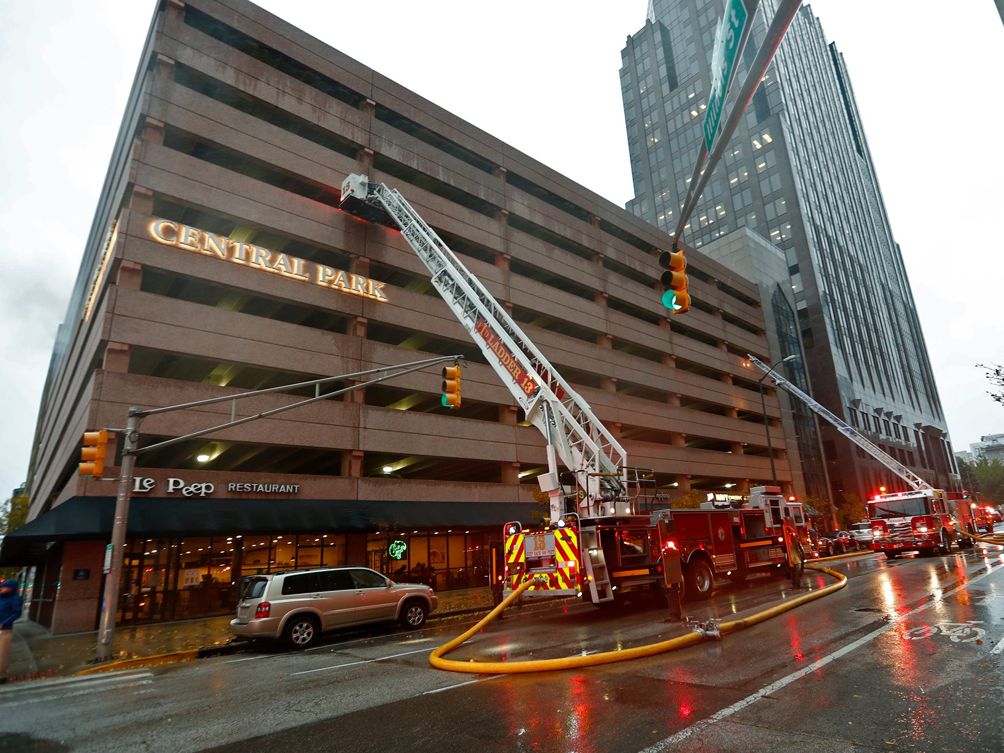 IFD fights a car fire in a parking garage at Illinois and New York, Thursday, Nov. 1, 2018.