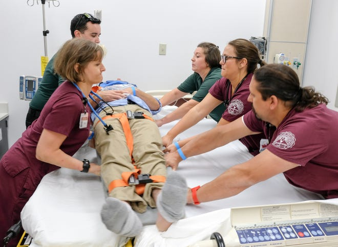 Nursing Academy students, along with their University of Indianapolis classmates, participate in a simulation exercise as part of their training. They combine their classroom work with clinical rotations exclusively at Community Health Network sites, which positions them well to enter jobs with the Network upon graduation.