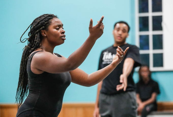 Maciah Schumpert, left, and Lanel Scott, right, practice a dance routine during an Iibada Dance Company class at Broadway United Methodist Church in Indianapolis Ind. on Wednesday, Oct. 31, 2018. The children's nonprofit dance studio teaches cultural enrichment, discipline, and positive self-esteem through the art of dance.