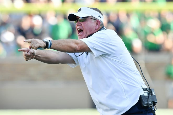 Notre Dame Fighting Irish head coach Brian Kelly yells to his players -- and goes a little pink in the face -- during the fourth quarter against the Vanderbilt Commodores at Notre Dame Stadium on Sept. 15, 2018.
