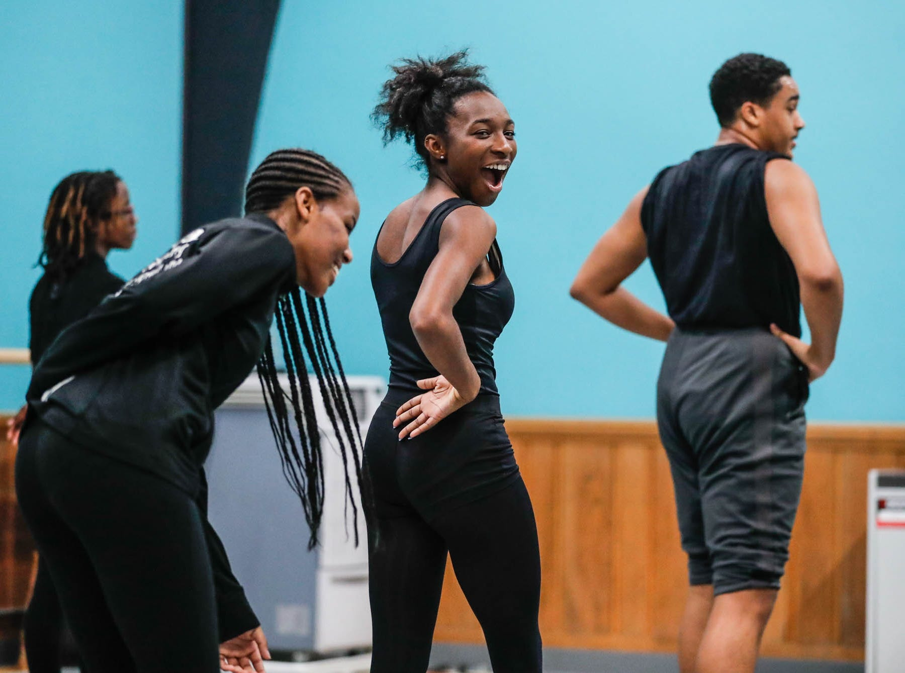 Iyannah Eaton, center, laughs while learning a dance routine during an Iibada Dance Company class at Broadway United Methodist Church in Indianapolis Ind. on Wednesday, Oct. 31, 2018. The children's nonprofit dance studio teaches cultural enrichment, discipline, and positive self-esteem through the art of dance.