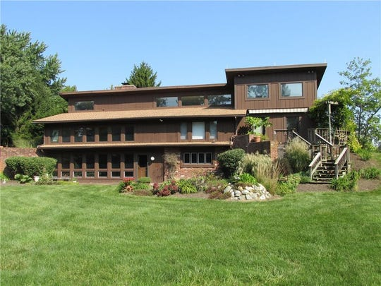 This unusual, 4,800 square-foot home in the Crooked Stick neighborhood of Carmel is currently listed for $629,900.