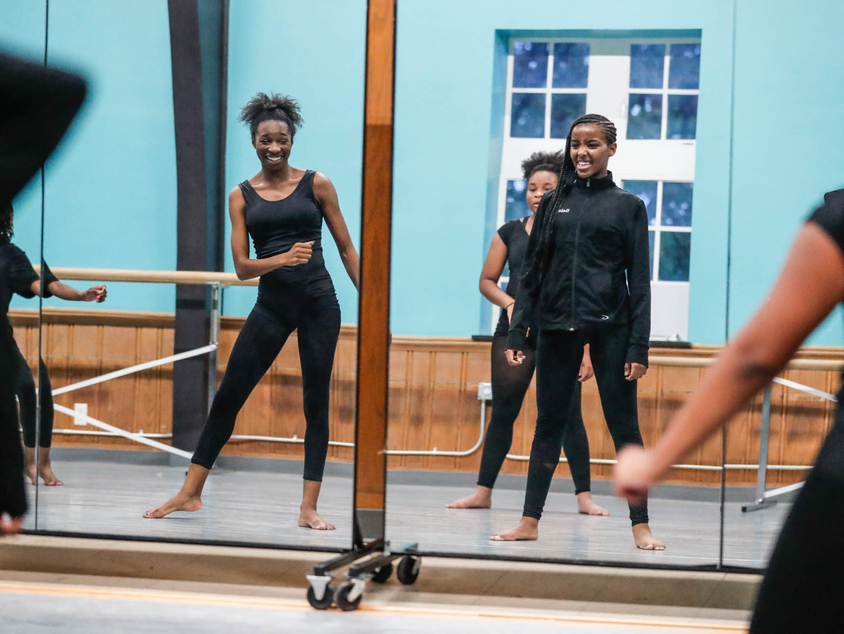 Students Selam Price, left, and Iyannah Eaton, right, watch in the mirror during an libada Dance Company class at Broadway United Methodist Church in Indianapolis Ind. on Wednesday, Oct. 31, 2018. The children's nonprofit dance studio teaches cultural enrichment, discipline, and positive self-esteem through the art of dance.