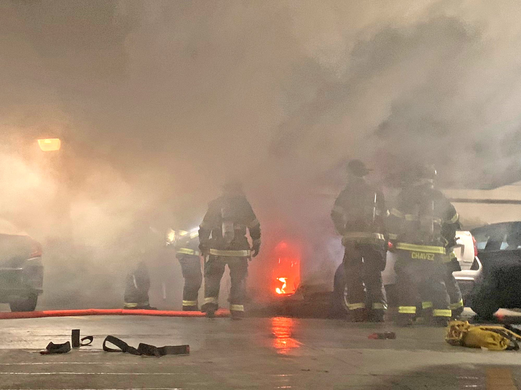 Smoke fills the garage as IFD fights a car fire in a parking garage at Illinois and New York, Thursday, Nov. 1, 2018.