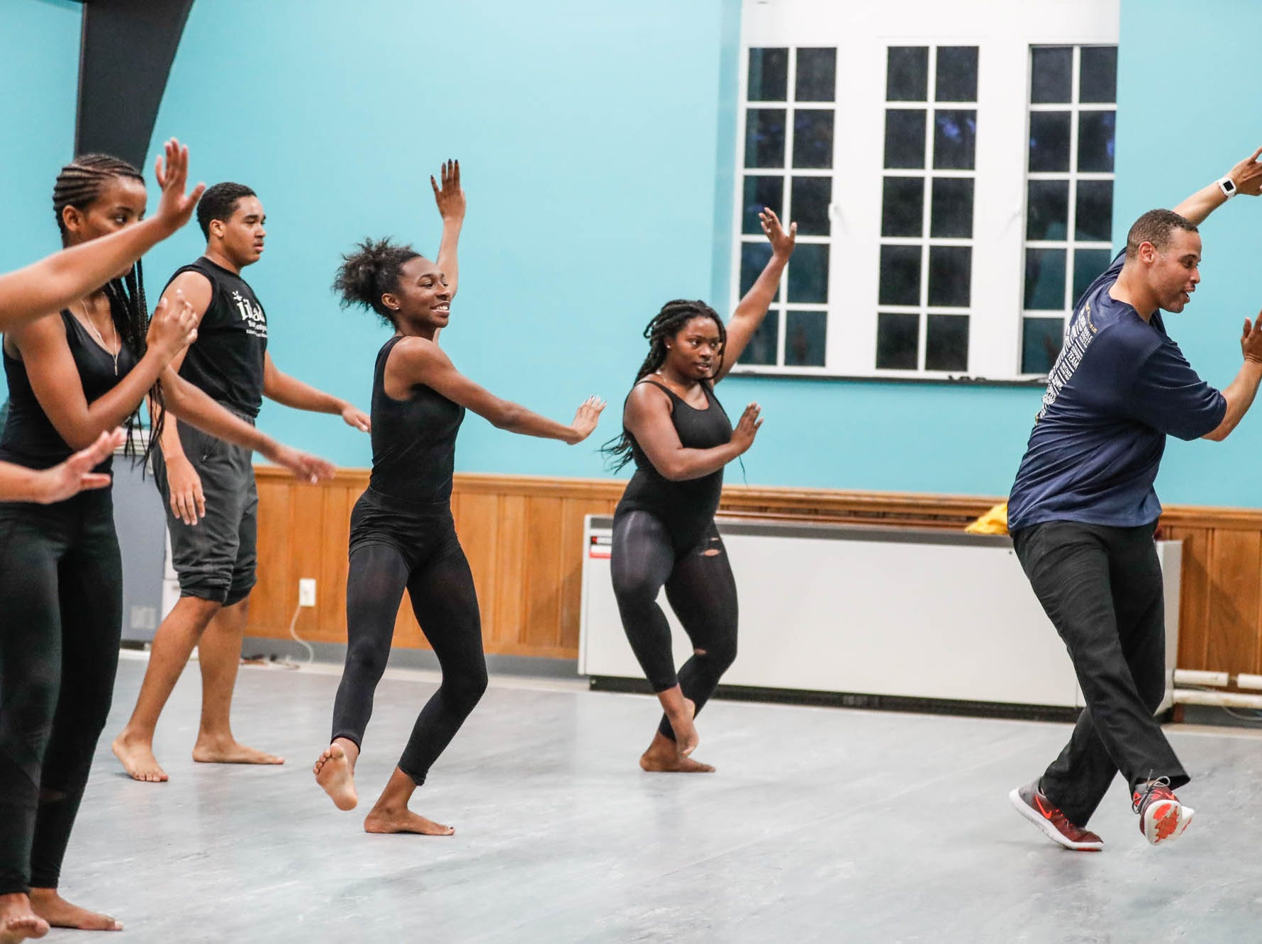 Senior Program Director, Roland Smith, right, teaches students dance moves during an Iibada Dance Company class at Broadway United Methodist Church in Indianapolis Ind. on Wednesday, Oct. 31, 2018. The children's nonprofit dance studio teaches cultural enrichment, discipline, and positive self-esteem through the art of dance.